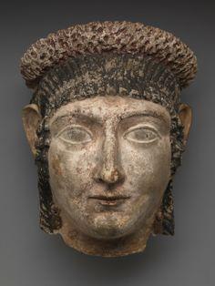 Mummy mask of a Woman Unknown artist, Roman-Egyptian Mummy mask of a Woman, 50–100 CE Plaster and paint