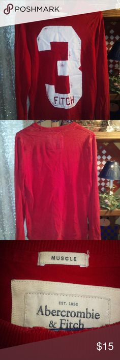Abercrombie and Fitch Muscle Shirt This is a red Long sleeve, size small muscle soft shirt. 100% Cotton. Like a sweatshirt but lighter. It has the number 3 on the front with Fitch. The 3 is all in a crackly white with Fitch in red. It has been very loved and the last 2 pics show signs of wear on the cuffs and bottom hem. Lots of Love Left!! ** Please note- The collar also has signs of wear, just like the cuffs and bottom hem**- To me it just adds Character to this awesome shirt!! Abercrombie…
