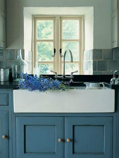 Cabinets are too blue but I love the farm sink and tile backslash
