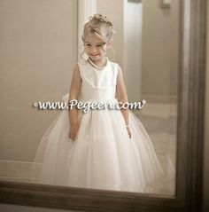 Custom flower girl girl dress in white tulle and trellis silk with bahama breeze sash and shells in the skirt | Pegeen ~ Located 1 mile from Disney World, Selling online and shipping worldwide. Call us for design help! 407-928-2377