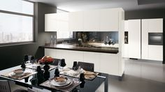 Sophisticated and featuring a contemporary look, they blend the different styles and requirements of everyday living. Modern Kitchen Island, Modern Kitchen Cabinets, Modern Kitchen Design, Modern Kitchens, Kitchen Designs, Kitchen Backsplash, Scavolini Kitchens, Black Glass Dining Table, Italian Kitchen Decor