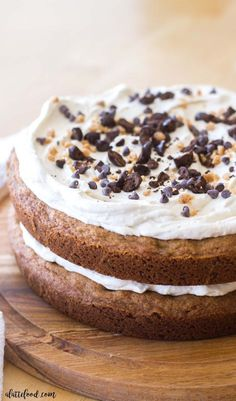 This easy chocolate chip cookie cake is the perfect dessert for any chocolate lover! Chocolate chip cookie dough is baked into two giant cookies, filled with coffee cream frosting, and topped with toffee bits, espresso beans, and mini chocolate chips. Rich, chocolatey, and perfect.
