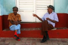 TWO GENTLEMEN OF CUBA. Trinidad, Cuba BAREFOOT is a series of StreetLife Photographs shot by Coxy during her trips around the world. Every picture captures the essence of people living on the streets as to prove that Beauty can be found around every corner.   Every Time you purchase a photograph from the BAREFOOT series, part of the proceeds are donated to benefit the homeless in the city of Los Angeles.   Shop it now on
