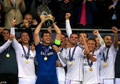 Hands on the trophy: Iker Casillas lifts the UEFA European Super Cup alongside Real Madrid...