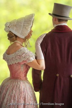 Trevillion Images - victorian-couple-in-hats-outside