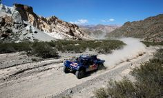 Carlos Sainz (#303) Carlos Sainz of Spain and Timo Gottschalk of Germany for the Buggy Smg-Red Bull Rally Team compete on Day 3 of the Dakar...