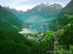 Forested mountains, valley and lake of Geiranger fjord in Norway.
