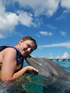 Get your first kiss at Dolphin Discovery Cozumel