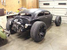 Chopped, Cut, Fenderless VW Beetle, Hot Rod sittin' on 20's & 19's.