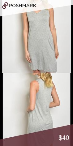 """Light Grey Midi vneck asymetrical dress This versatile light grey dress goes from office to weekend wear with little effort. Need a dress that packs and travel well? This is your go-to-must-have wardrobe item!Front has a rounded v neckline, asymmetrical hemline and material is super soft! Feels so rich and flatters so many figures! I also have this dress in oatmeal in my closet. Approx S:B:17""""W:18""""L:33-35.5"""" M:B:18.5""""W:19""""L:33-36.5"""" L:B:20""""W:21""""L:34-37.5"""".✅I ship same or next day ✅Bundle for…"""