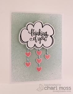 I like the use of the washi tape (or stamped?) strips along the bottom with a die cut focal point. RainingHearts by Chari Moss, via Flickr