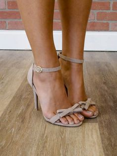 """These dressy sandals are adorable and so versatile. The adjustable ankle strap, 4"""" heel, faux suede, adorable bow detail, and comfortable arch make these perfect for your next special occasion. Runs t"""