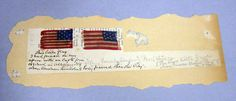 """Two silk US flags that measure 1.50 x 1"""".  The newsprint paper has a hand written note that reads, """"This little flag I had pined on my apron with an Eagle pin at school in Albany, N.Y. when Abraham Lincolns body passed thro the City- """"AlbanyFemale Academy"""" Pearl Street- (The other little (flag) I wore when he was elected Pres. of the U. States."""" One flag has 13 stars {& 13 stripes.other flag has 13 stars & 9 stripes"""