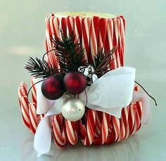 Candy cane candle - great simple centerpiece idea!   Use taller candle!