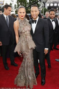 Stunning! Chrissy Teigen and John Legend shined on the red carpet at the Golden Globes on Sunday night
