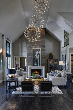 Light contemporary great room / living room with dark rustic wood floors, stone fireplace and orb chandeliers Home Living Room, Living Room Designs, Apartment Living, Warm Living Rooms, Dark Wood Floors Living Room, Minimal Apartment, York Apartment, Apartment Furniture, House Furniture