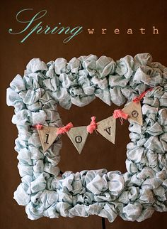 Adorable wreath made from king size sheets and clear hair bands onto a wood frame! So cute!!!