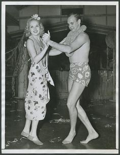 Betty Grable dances with husband Jackie Coogan at Hawaii-themed party in Hollywood.