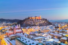 Panorama of Ljubljana in winter. by kasto. Aerial panoramic view of Ljubljana decorated for Christmas holidays. Roofs covered in snow in winter time. Winter Sun Destinations, Christmas Destinations, Europe Destinations, Travel Europe, Travel Abroad, Travel Packing, Riverside Cafe, Most Beautiful Cities, Bratislava