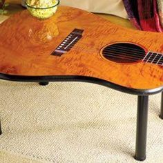 Guitar Table - find a cheap guitar (Goodwill?) make this and the neck lamp!) :)