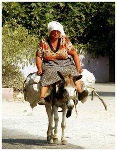 Albania - Albanian woman on a donkey
