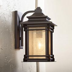 Add warmth to a porch or patio with the soft glow of this Americana inspired lantern design