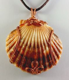 Wire Jewelry Naturally Colored Rust and Copper Scallop Shell Pendant - JTF Jewelry - This Dark Brown and orange-mottled scallop shell with the tan highlights is simply amazing. It just begged to be wrapped in copper colored wire, so that's Seashell Jewelry, Seashell Crafts, Sea Glass Jewelry, Crystal Jewelry, Seashell Necklace, Pendant Necklace, Wire Wrapped Jewelry, Wire Jewelry, Jewelry Crafts