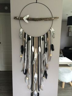 A sublime dreamcatcher made entirely by hand from natural driftwood from Lake Geneva and Le Bourget. Finely worked and embellished with various feathers, accessories, wooden beads and ceramic. It also presents a branch of driftwood dressed in ribbons in Home Crafts, Diy And Crafts, Dreamcatchers, Metallic Paint, Wooden Beads, Diy Wall, Driftwood, Decoration, Wind Chimes