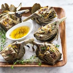 Grilled Artichokes « Go Bold with Butter (I would imagine that these would be great with extra virgin olive oil as well)