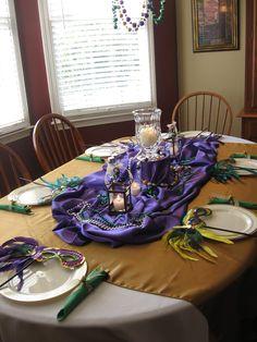 A Mardi gras themed table (like the purple fabric idea)