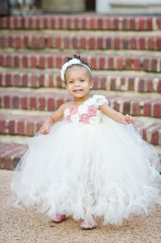 the cutest flower girl for this pastel pink wedding shoot. repin this to show everyone how adorable she is! we love this. #flowergirl #weddingideas #pastel