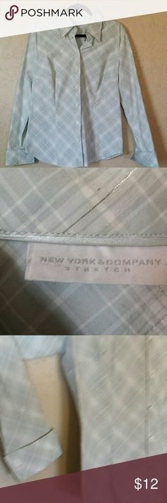 New York & Company long sleeved shirt Long sleeved button up shirt with pleats in the front and back with cuffed sleeve. This is a tailor shirt. No damage, rips, tears, or stains.  60 cottton/37 polyester/3 spandex. Light blue and white with silver thread running through. New York & Company Tops Blouses