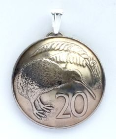 Beautiful pendants made from authentic coins from around the world!  Many countries and designs available, go to http://lamgallery.etsy.com/ to see more!!  New to lamgallery on Etsy: New Zealand Kiwi Bird 20 Cent Domed Coin Pendant Vintage Necklace Jewelry Unique Charm Foreign World FREE SHIPPING (20.00 USD)