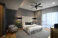 Luxury bedroom coupled with fine linens and simple furnishings.