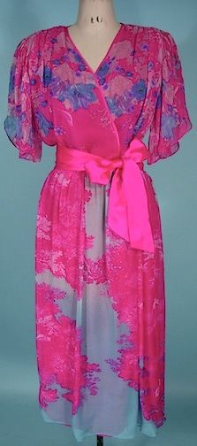 """c. early 1980's HANAE MORI Boutique Silk Chiffon Print Dress.  The details of the dress include open flutter sleeves, """"v"""" wrap neckline, lightly padded shoulders with gathering, elastic waist, hot pink satin edging and tie sash belt, lined in raspberry crepe, Floral silk chiffon colors are raspberry, light pinks, light blues, aquas, lavendars in a cherry blossom tree motif with small birds hidden in the print."""