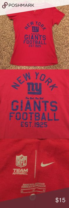 Nike NY Giants Tee NY Giants t-shirt made by Nike's NFL Team Apparel line. Very gently worn and in great condition. Size medium but fits a little snug, more like a small. Nike Tops Tees - Short Sleeve