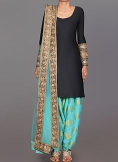 Black and Mint Brocade Punjabi Suit features a taffeta silk kameez alongside a brocade bottom with santoon inner and net dupatta. Embroidery is completed with zari, lace and stone embellishments. Churidar, Indian Salwar Kameez, Anarkali, Salwar Suits, Patiala Suit, Designer Salwar Kameez, Lehenga, Punjabi Fashion, Gowns