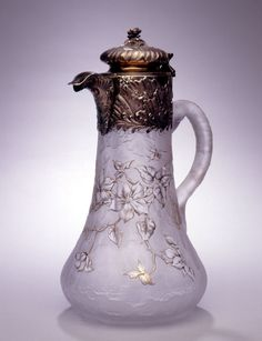 French silver gilt Art Noveau Claret Jug , frosted glass is carved to leave in relief branches of flowering Clematis that are polished clear and then gold leafed on the outer edges, Paris, Circa 1890.