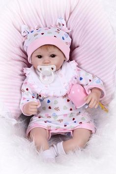 This adorable preemie reborn baby doll is handmade, is crafted with hand painting, hand-rooted mohair, hand sewn heart print outfit and includes magnetic pacifier and bottle.