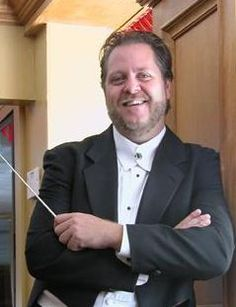 Audiences beyond Sarasota, including those in Sister City communities including Treviso Province, Italy and the Kingdom of Fife in Scotland, have come to love the passionate conducting, engaging personality, and creative programming of Maestro Joseph Caulkins, Artistic Director for Sarasota's Key Chorale