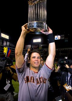 Buster Posey, 2010  Buster celebrates after winning the 2010 World Series in Texas.  Brad Mangin Photography