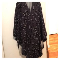 LF Leopard Wrap LF leopard print poncho. Perfect for bundling up or layering. Worn once. No holes/stains/smells LF Sweaters Shrugs & Ponchos