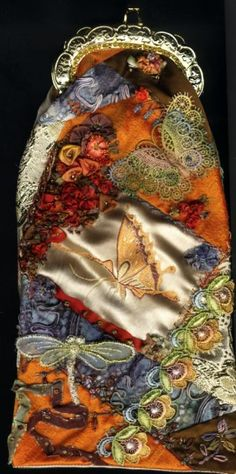 Purse made from crazy quilt with buttons,  beading, silk ribbon flowers, motifs and ornate embroidery  stitching.
