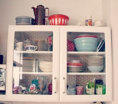 kitchen cabinet makeover, complete with Orla Kiely wrapping paper backing!