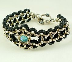 Unusual Double Sterling Silver & Black Rubber Aquamarine Swarovski Crystal Chainmaille Bracelet. $69.00, via Etsy.