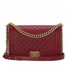 d12c3196b4e4 Chanel dark red lambskin New Medium Boy bag with antique gold tone  hardware, store fresh condition. Buy authentic Chanel handbags at Madison  Avenue Couture