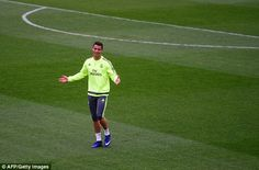 In-form Ronaldo looked in good spirits during the session and gestures towards the bench