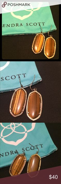 Kendra Scott Elle Earrings Tiger's eye and gold Kendra Scott earrings go with everything! These are the smaller size and have been loved/worn a lot but still have life left. There is tarnishing on the gold. Kendra Scott Jewelry Earrings
