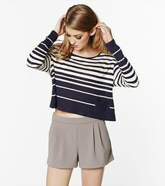 Sail in the right direction with this playful striped cropped navy top!