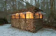 """Tiny recording studio in the woods, looks fully like stacked pile of logs when shutters are down.""  BRILLIANT!!!"